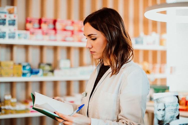Female pharmacist working at store