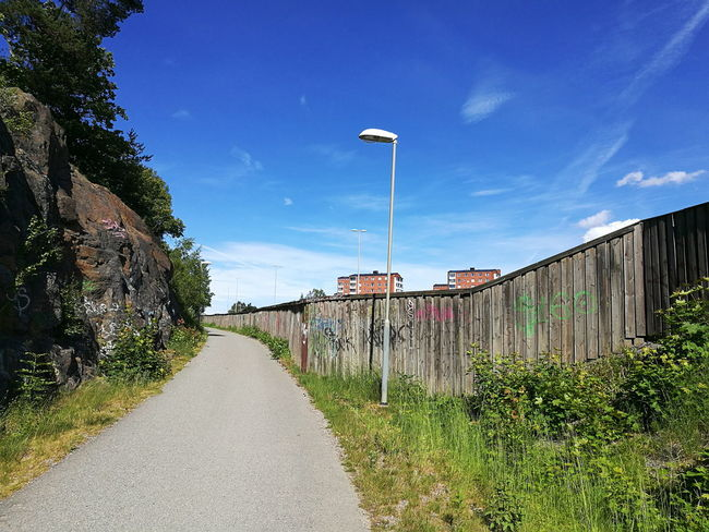 Sky Outdoors Day No People Tree Nature Clouds Stockholm, Sweden Traveling City Sweden Wall Contrast Urban Graffiti Grass Geometry In Nature Summer Pathway