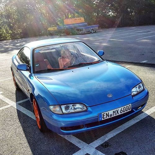 My '92 Mazda Mx6 got Wrapped with Averydennison Brightbluemetallicgloss and looks awesome now! Mazdafamilia Jdm Import DOHC Blue Hankook Instacar Instacars Summer Mazdagram Mazdamovement Paintisdead Vinylwrap Mymazda Mxlife Orange Rims Magnaflow