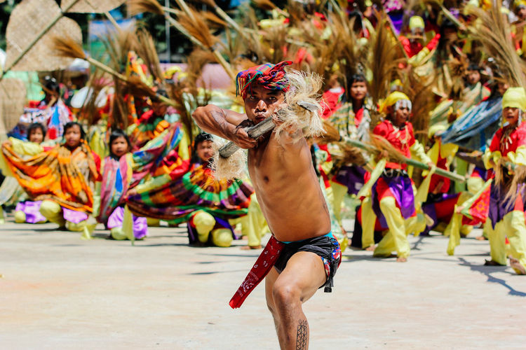 Full length of shirtless man dancing