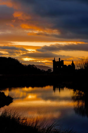 Kilchurn Castle, on the shores of Loch Awe, Argyll & Bute, Scotland, at sunset. Architecture Argyll Beauty In Nature Castle Cloud - Sky Colors Colours Dramatic Sky Idyllic Kilchurn Lake Landscape Loch Awe Nature No People Outdoors Reflection Scenics Scotland Silhouette Sky Sunset Travel Tree Water