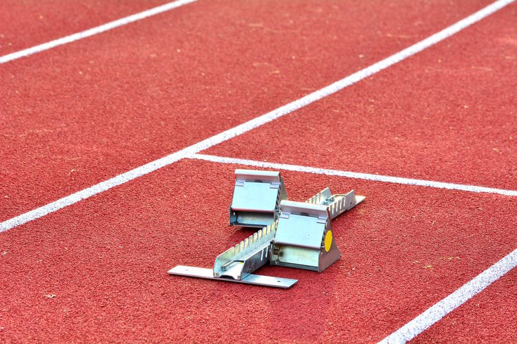 High angle view of starting block on running track