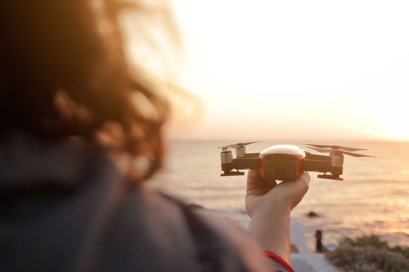 Drone in action Mavic Air Holding Woman Sunset Bulgaria Action Sunrise Drone  Photography Themes Camera - Photographic Equipment One Person Sky Holding Photographing Technology Activity Nature Headshot Real People Lifestyles Leisure Activity Close-up Rear View Adult Photographic Equipment Camera Digital Camera Portrait
