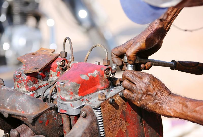 engine repair Human Hand Hand Transportation Real People Human Body Part Mode Of Transportation Bicycle Focus On Foreground Land Vehicle One Person Day Men Close-up Occupation Body Part Metal Outdoors Nature Human Finger Finger