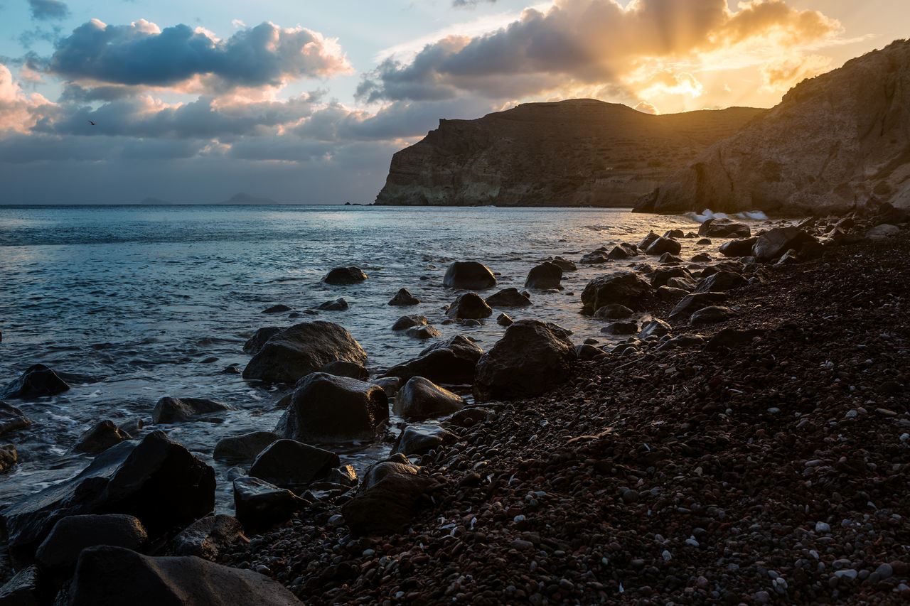 Sunset on the Red Beach of Santorini, September 2018. Santorini is famous for its stunning sunsets. From the Red Beach you won't see the sun diving in the sea, as in other locations such as Oia, but if you're looking for a peaceful place, that's it. It was a pleasant feeling: Being alone, contemplating the magnificence of nature, away from the crowds of people visiting the island of Thira. Beach Beauty In Nature Cloud - Sky Greece Horizon Horizon Over Water Idyllic Land Nature No People Non-urban Scene Rock Rock - Object Rocky Coastline Santorini Scenics - Nature Sea Sky Sunset Tranquil Scene Tranquility Water