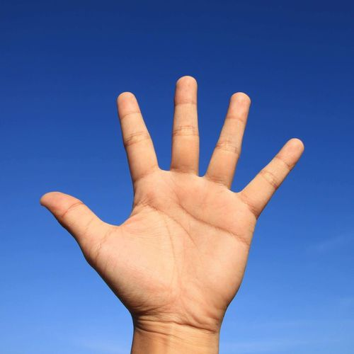 Human Hand Human Body Part Blue Human Finger Gesturing Communication Clear Sky Day One Person Outdoors Low Angle View Stop Gesture Sky Close-up People