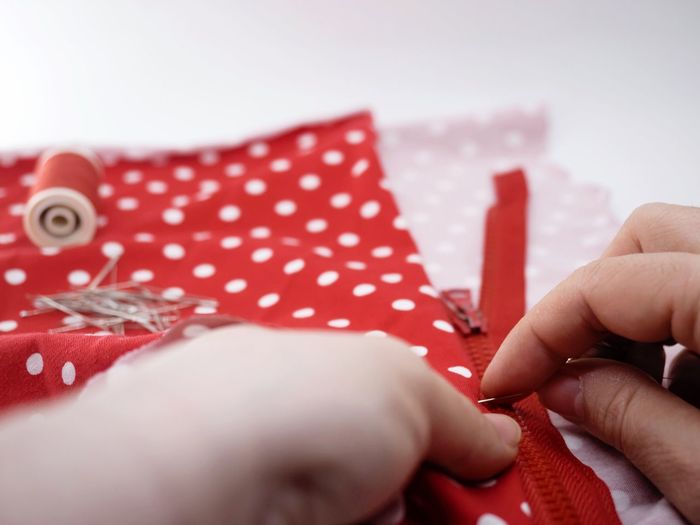 Handmade Handcrafted Art And Craft Sewing Human Body Part Working Hands Workingplace Polka Dot Fabric Human Hand Red Human Body Part Christmas One Person Holding Human Finger Close-up Real People Indoors  Lifestyles Business Stories