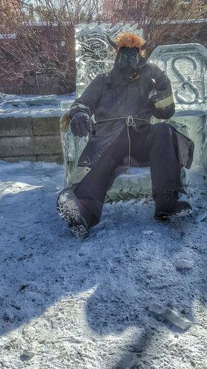 Villian sitting on his throne of ice plotting his next attempt at world domination. Taken in front of the Hotel Saranac in Saranac Lake, NY during the 2016 winter carnival. Carnival Villian Villians Superheroes Winter Fantasy Ice Sculpture Throne Snow Masked Man Dressed In Black  Escapism Fun Small Town Adirondacks Saranac Lake Robe Horns Horned Winter Carnival Real People