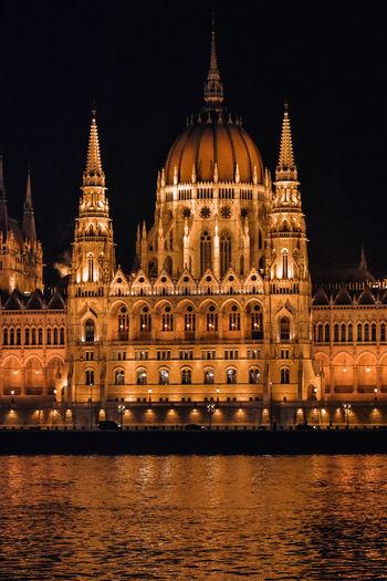 Illuminated Hungarian Parliament Building Against Sky At Night