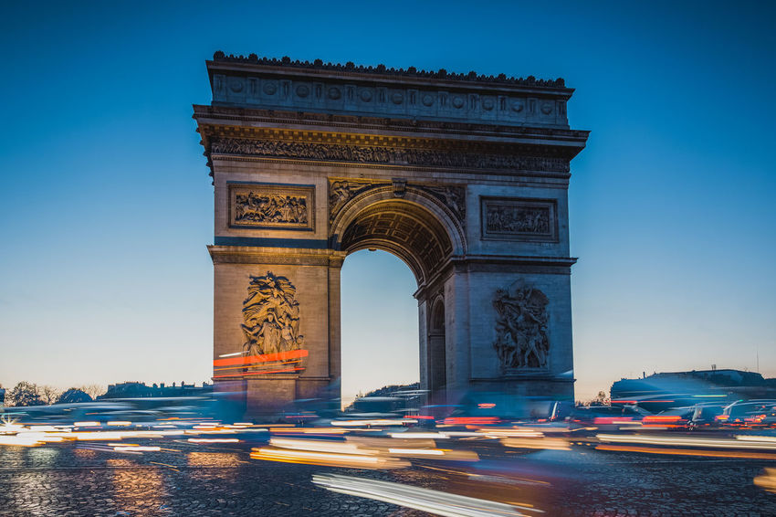 Arch Architecture Avenue City Clear Sky Cultures Day History Illuminated Light Trail Long Exposure No People Outdoors Paris Sky Travel Destinations Triumphal Arch War
