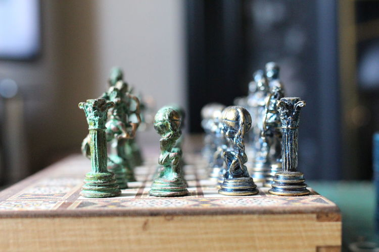 Close-up of chess pieces on book