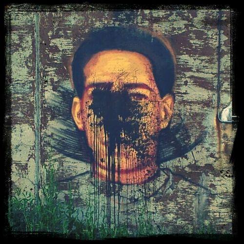 Defaced mural.