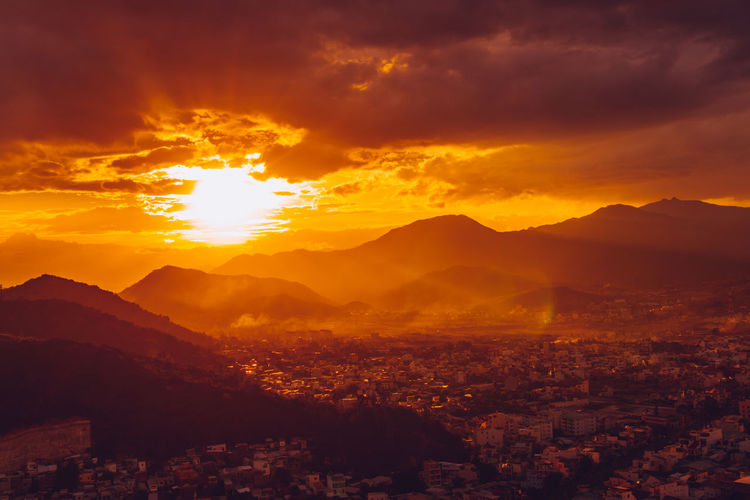 Nha Trang cityview on sunset Architecture Beauty In Nature Building Exterior City Cityscape Cloud - Sky Environment Landscape Mountain Mountain Range Nature No People Orange Color Outdoors Scenics - Nature Sky Sun Sunlight Sunset Tranquil Scene Tranquility Capture Tomorrow