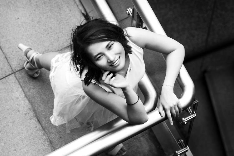See her down there! Beauty Black And White Cute Enjoyment Girl Handrail Metal High Heels Innocence Smiling Top Down View White Dress Woman Woman Who Inspire You Sophie Wu