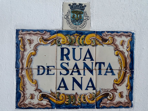 """Portugal EyeEm ZOOM in to see details... Constância, almost all street names in this town are hand painted on """"azulejos"""": https://en.wikipedia.org/wiki/Azulejo. Here are some examples of this beautiful Art... Communication Text Wall - Building Feature No People Western Script Sign Information Information Sign Close-up Day Design Metal Blue Representation Indoors  Guidance Gray Built Structure Art And Craft Architecture Ornate"""
