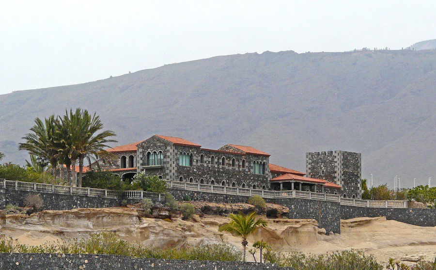 An unusual fortified granite villa - Spanish island of Tenerife - Canary islands Fortified Villa Island Of Tenerife Architecture Beauty In Nature Building Exterior Built Structure Canary ıslands Day Granite Building Mountain Mountain Range Nature No People Outdoors Scenics Sky Travel Destinations Tree Water Roman Villa Style