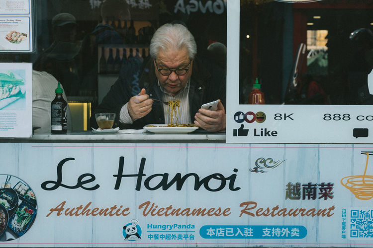 . London Streetphotography Street Communication Text Business Front View Food And Drink Real People One Person Drink Portrait Adult Transparent Western Script Indoors  Headshot Lifestyles Eyeglasses  Men Refreshment Restaurant The Street Photographer - 2019 EyeEm Awards