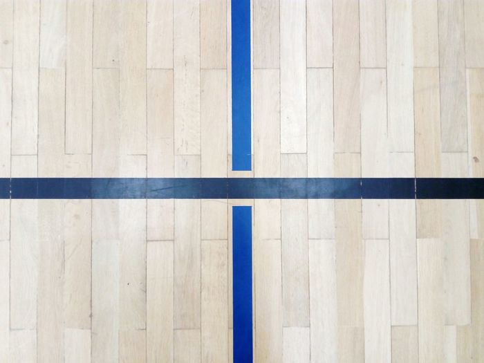 playing field limit lines on the parquet in a gym sports center Gym Sports Arena Parquet Playing Field Field Lines Field Limits LINE Limit Cross Black Blue Indoor Sports Ball Sports Sport Wood - Material Hardwood Floor Backgrounds Pattern Old-fashioned Directly Above Textured  Wood Paneling Blue Indoors  Hardwood Close-up
