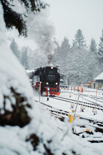 Train on snow covered railroad track