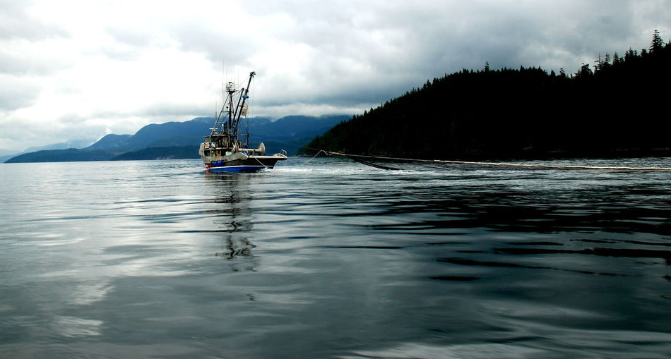 Canadian Trawler Beauty In Nature Cloud - Sky Day Mode Of Transport Mountain Nature Nautical Vessel No People Outdoors Reflection Salmon Fishing Salmon Trawler Scenics Sky Transportation Trawler Tree Water Waterfront