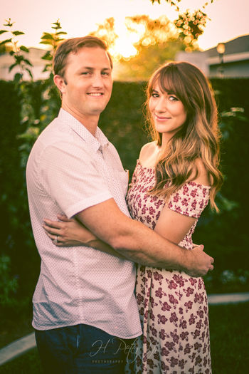 Tara and Jorgan | As the sunset was near, I led Tara and Jordan over to a corner of the backyard and had them stand backlit by the sun. I told them to hold each other. The glow cast around the love birds was just beautiful. And all I had to do was framing them just right with the sunset glow peeking through the trees. What a lovely newlywed to take photos of. Corona, CA Affectionate Bokeh Bokeh Photography Couple - Relationship Happiness Holding Each Other Lifestyle Lifestyle Photography Lifestyles Love Lovely Couple Nature Newlywed Outdoors People Real People Smiling Standing Sunset Sunset Glow Togetherness Tree Two People Wedding Wedding Reception