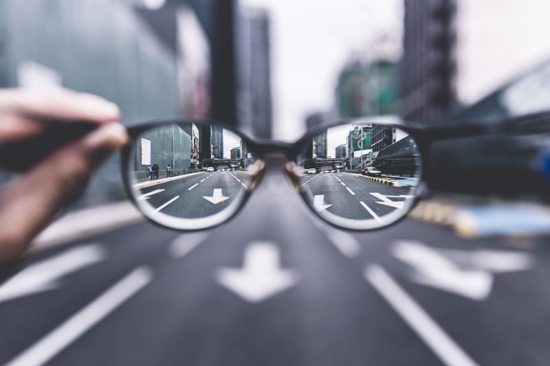 City Street Seen Through Eyeglasses