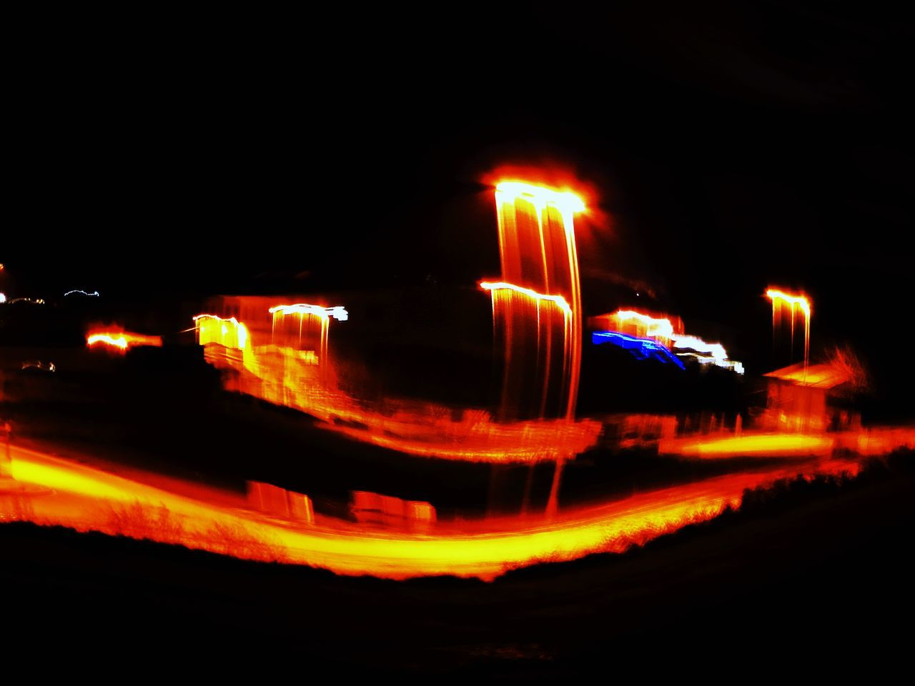 illuminated, night, blurred motion, outdoors, speed, mode of transport, motion, no people, transportation, city, architecture, sky