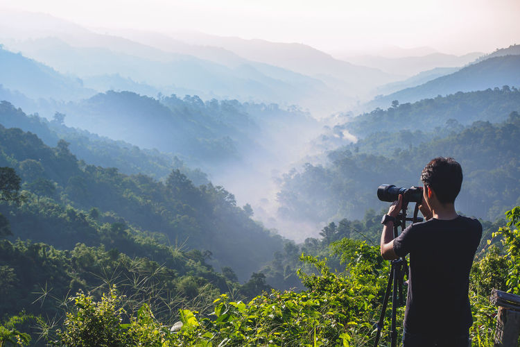 Cameraman enjoying the nature view of hills and mountain are complex in the morning sunrise