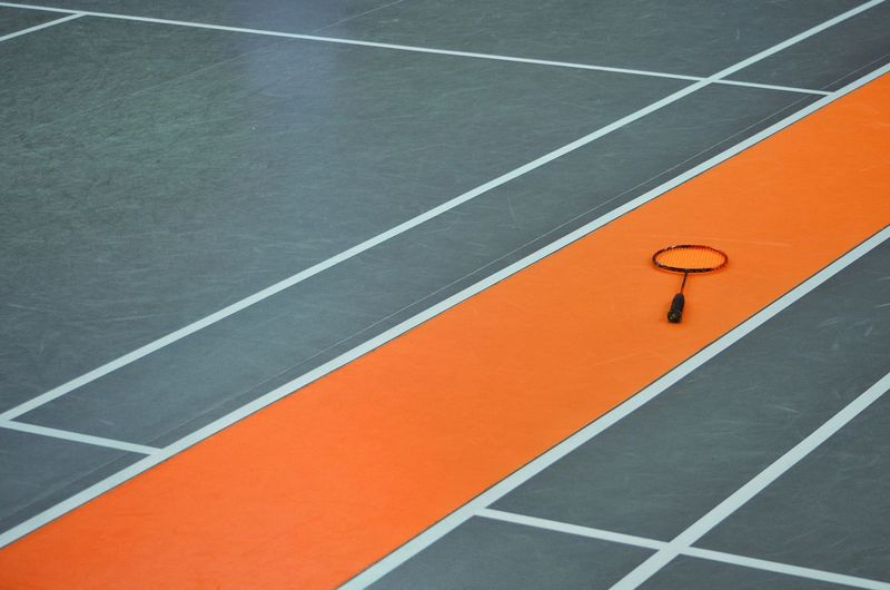 High angle view of badminton racket on floor