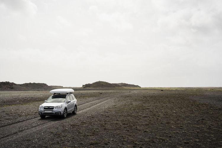 Car on land against sky