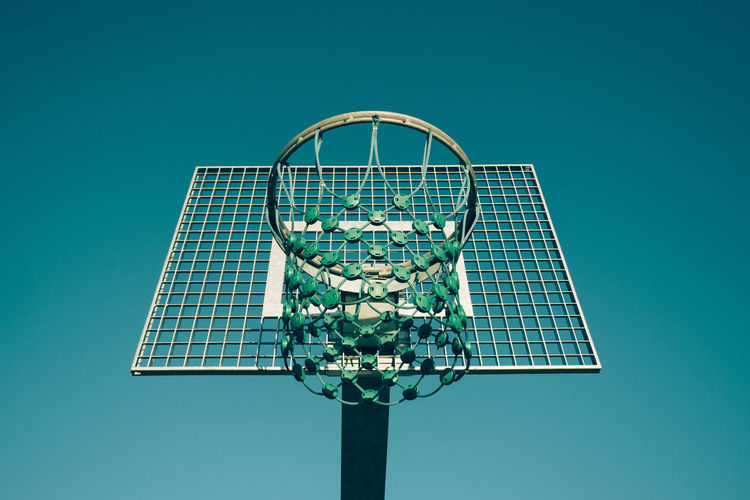 basketball basket Basketball Hoop Blue Background Clear Sky Close-up Colored Background Day Low Angle View No People Outdoors Sky Sport Sports