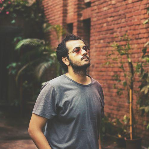 Young Man Wearing Sunglass At Yard