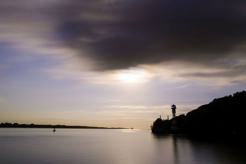 Silhouette Sunset Water Cloud - Sky Landscape Reflection Beauty In Nature Nature Scenics Outdoors Lake Tranquil Scene Sky Tranquility Tree Summer Travel Destinations Vacations Lighthouse Elbe River Elbe River Dramatic Sky