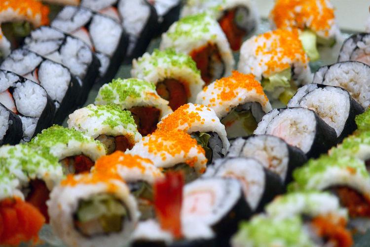 Full frame shot of sushi served in plate