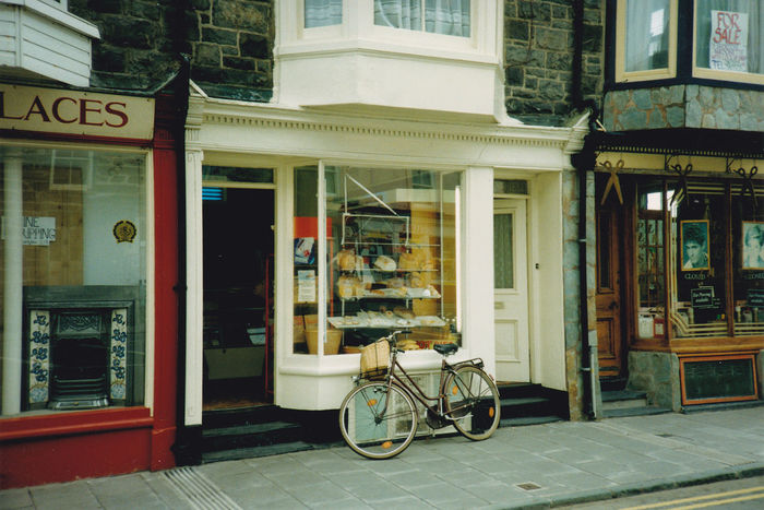 A pie shop next to a barbers.............. Film Photography Pie Shop Cake Shop Hairdressers  Old Bicycle Bicycle Transportation Architecture Mode Of Transport Building Exterior Built Structure Land Vehicle Outdoors