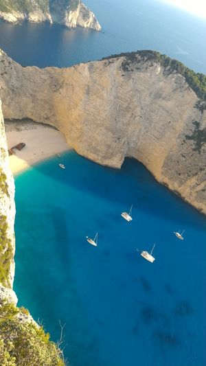 Travel Zakynthos Zakynthos Island Aerial View Beauty In Nature Day Flying High Angle View Holydays Mode Of Transport Mountain Nature Nautical Vessel No People Outdoors Rock - Object Scenics Sea Shipwreck Beach Sky Sun Tranquil Scene Tranquility Transportation Water
