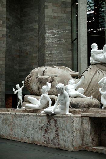 Statue against historic building