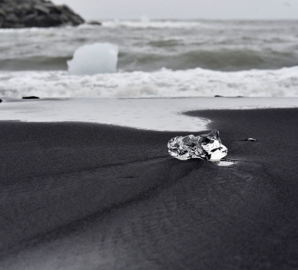 diamond beach close to Jökulsárlón glacial lagoon,ice crystal lies down on the black sand beach. Iceland Blacksandbeach Ice Wave Foamy Waves Blacksand No People Sea Beach Water Sand Scenics - Nature Beauty In Nature Land