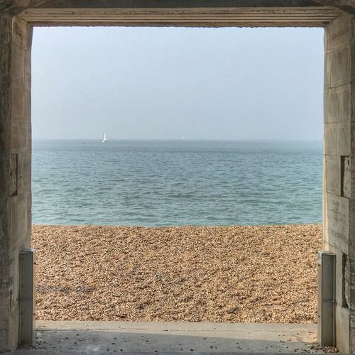 Sea door Sea Water Horizon Horizon Over Water Sky Beauty In Nature Scenics - Nature Window Clear Sky Architecture No People Outdoors Beach Day Idyllic Nature Tranquil Scene Land Tranquility