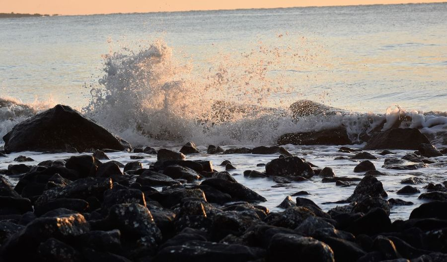 Rocks on the beach Rocks On The Beach, Rocky Shor Beach Beauty In Nature Breaking Crash Crashing Day Force Hitting Horizon Over Water Motion Nature No People Outdoors Pebble Beach Power In Nature Rock Rock - Object Sea Sky Water Wave
