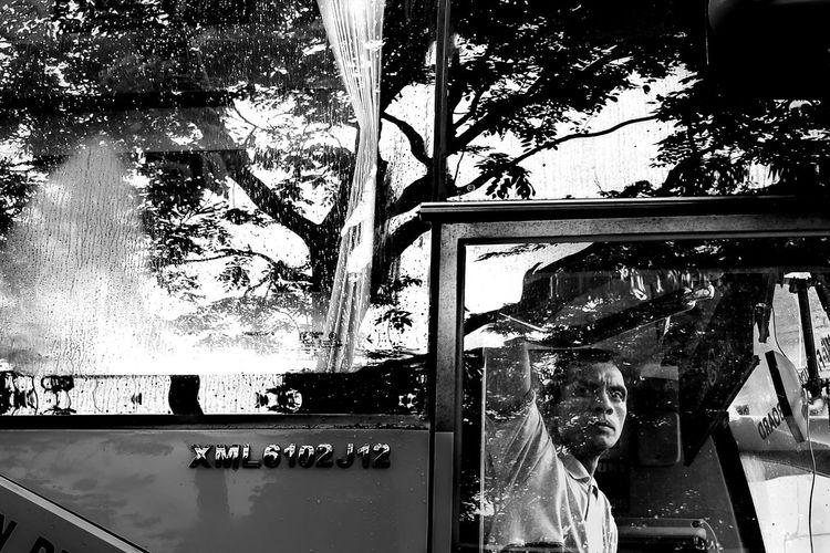 Reflection of boy on car window