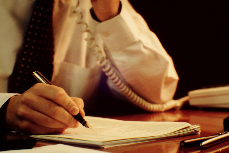 Close-up of man working at desk