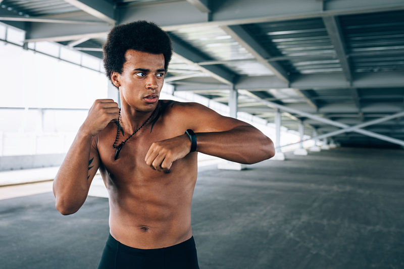 Bare Chest Athlete Young African American Outdoors Training Day Working Out Kickboxer Shadow Boxing One Person Sweat Looking Standing Lifestyles Healthy Copy Space Males  Muscular