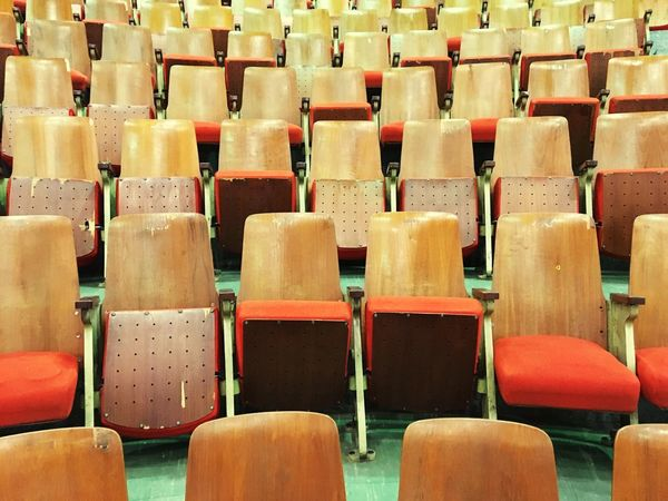 Chair In A Row Seat Empty Large Group Of Objects Full Frame Auditorium Backgrounds Day No People Indoors  Arrangement Abundance Education Lecture Hall