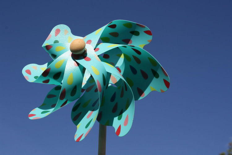 Close-up of pinwheel against clear blue sky