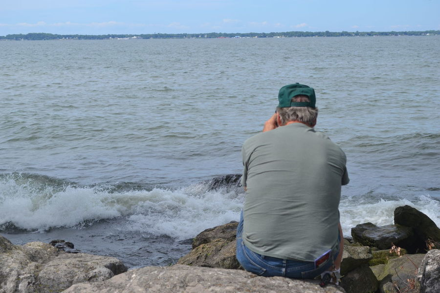 Dad Marblehead Marblehead Lighthouse Marblehead, OH Lighthouse A Picture Of Him Taking A Picture Beach Beauty In Nature Day Father Leisure Activity Looking At Camera Men Nature Ohio One Person Outdoors Real People Rock - Object Sea Sky Water