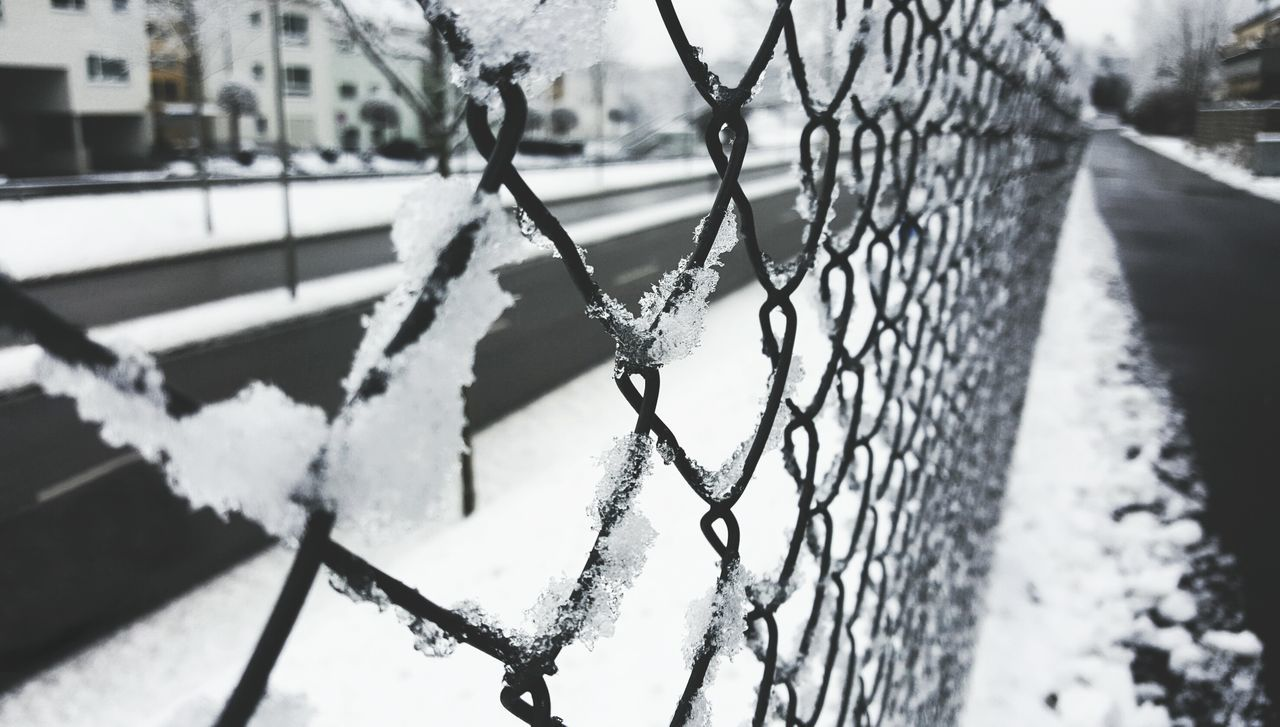 winter, cold temperature, snow, fence, barrier, focus on foreground, boundary, day, no people, architecture, nature, frozen, close-up, chainlink fence, safety, metal, built structure, protection, outdoors, ice, blizzard