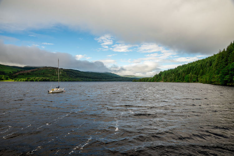 Loch Tay summer view in cloudy weather, central Scotland Family Hills Holiday Loch Tay Perthshire Scotland Scottish Spectacular Travel Cloud - Sky Cruising Fishing Highlands Killin  Lake View Lakeshore Landscape Sailing Boat Scenics Spectacular Scenery Summer Tourism Tourist Destination Yacht