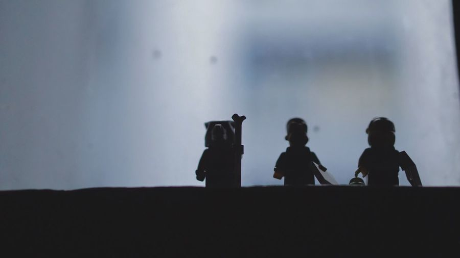 Close-Up Of Silhouette Figurines By Window At Home
