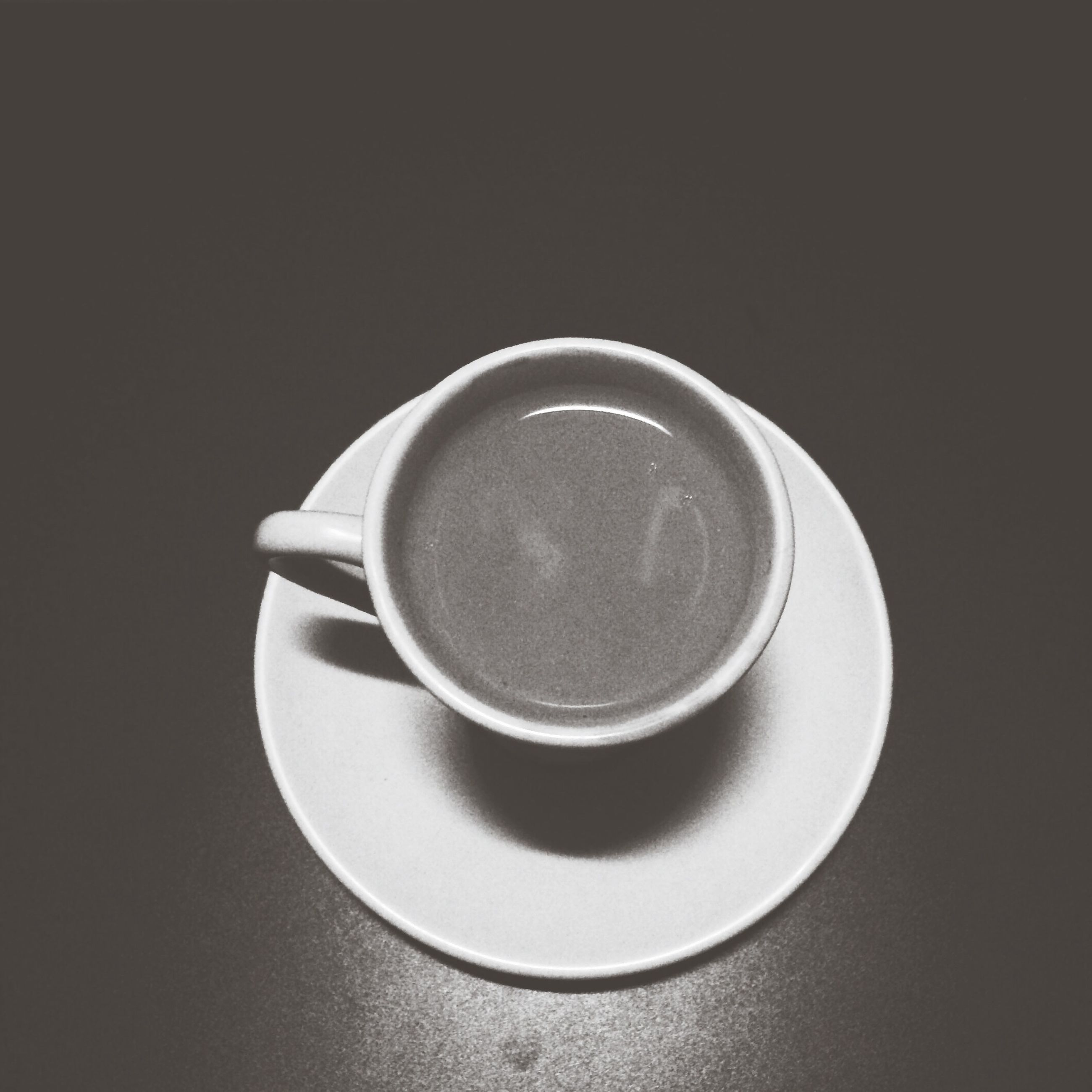 indoors, coffee cup, still life, studio shot, food and drink, drink, copy space, saucer, close-up, table, cup, directly above, refreshment, coffee - drink, black background, high angle view, no people, coffee, circle, white color